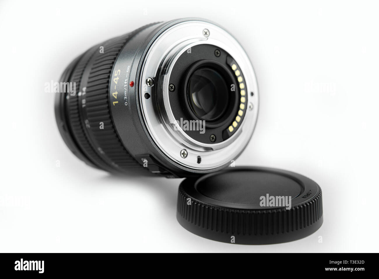 mirrorless dslr camera lens. close-up lens back surface with white background - Stock Image