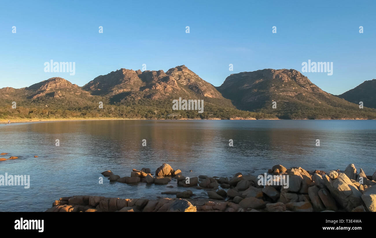 sunset shot of coles bay and the hazards - Stock Image