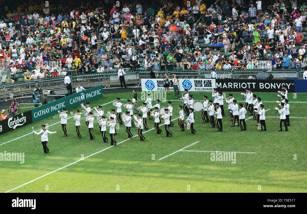 Musicians playing Bagpipes during the Half time break of the HK Sevens. - Stock Image