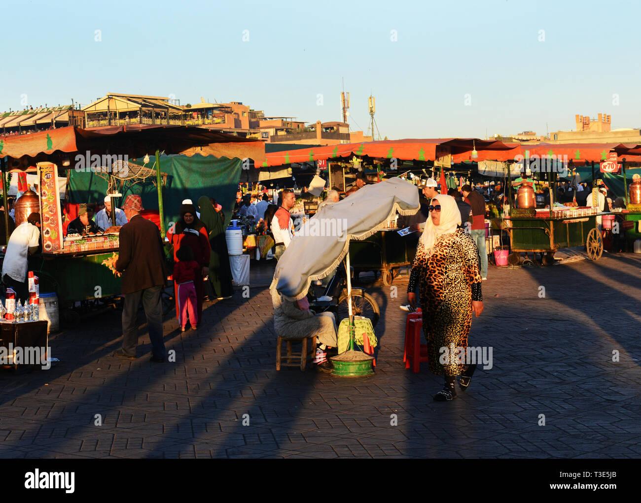 The colorful Djema el-Fna sq. in Marrakesh. - Stock Photo