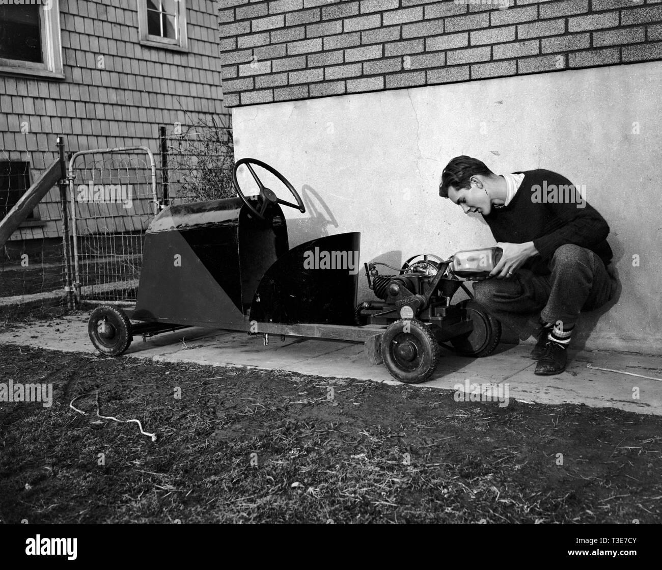 Boy Making Go Kart Stock Photos & Boy Making Go Kart Stock