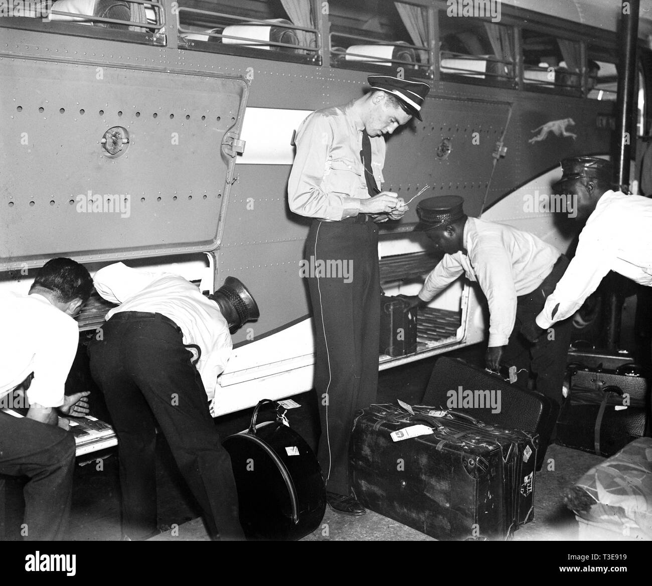 Workers At Greyhound Bus Station Loading And Checking Baggage Ca 1937 Stock Photo Alamy