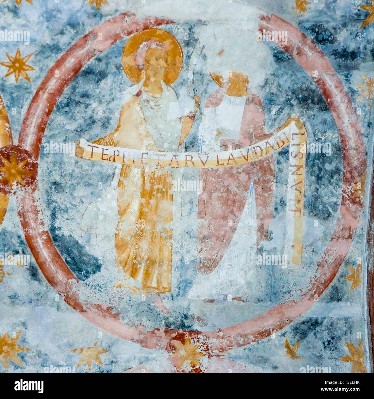 Saints with tekst bands of the creed , a romanesque wall-painting in byzantine style from 1121, Va church , Sweden - October 9, 2009 - Stock Image