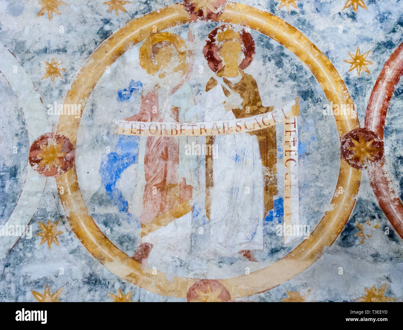 Saints with text bands of the creed , a romanesque wall-painting in byzantine style from 1121, Va church , Sweden - October 9, 2009 - Stock Image