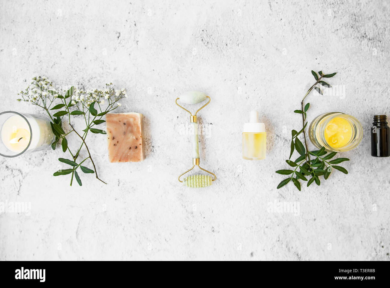 Natural Organic Skincare Products On Concrete Background Top View Green Natural Skincare And Beauty With Flowers Natural Soap Jade Roller Essenti Stock Photo Alamy