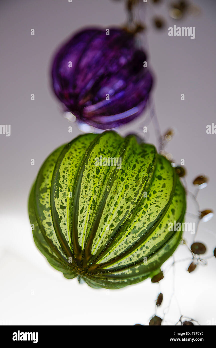 Green and violet decoration globes, detail - Stock Image