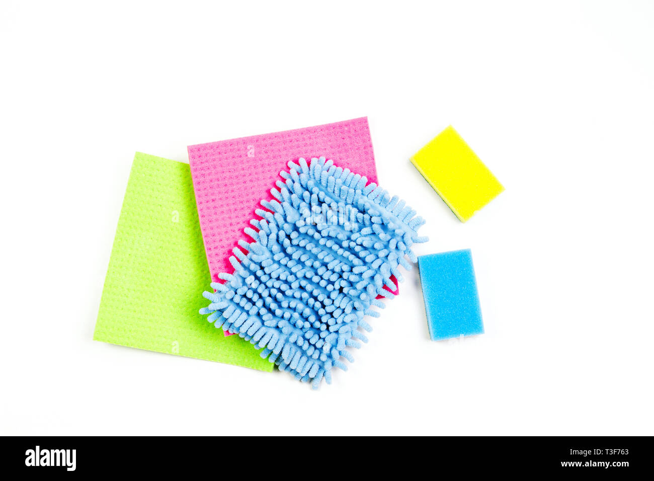 Housework, housekeeping, household, cleaning service concept. Multicolored rags and sponges on white background - Stock Image