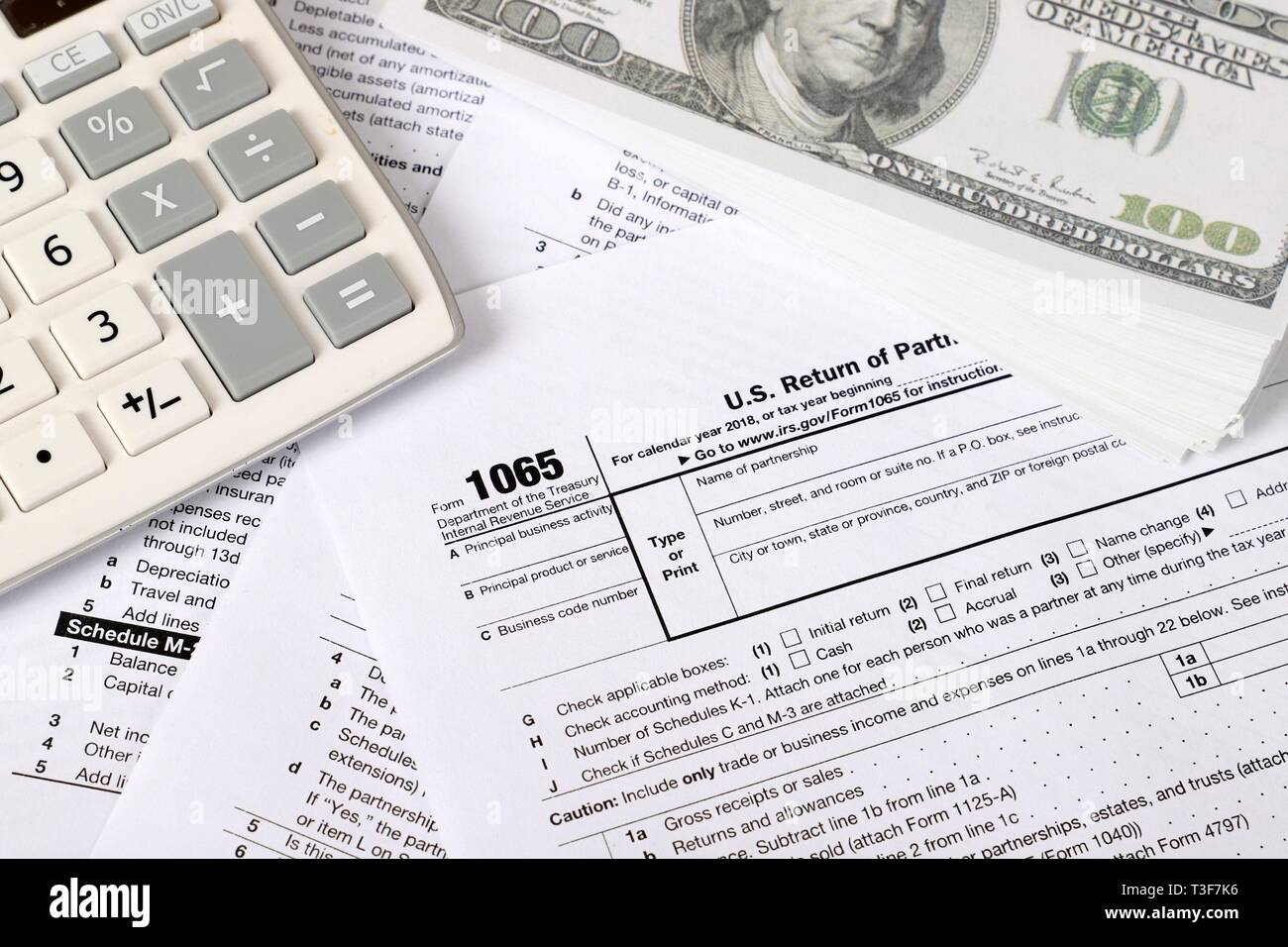 form 1065 calculator  14 tax form lies near hundred dollar bil and calculator on ...