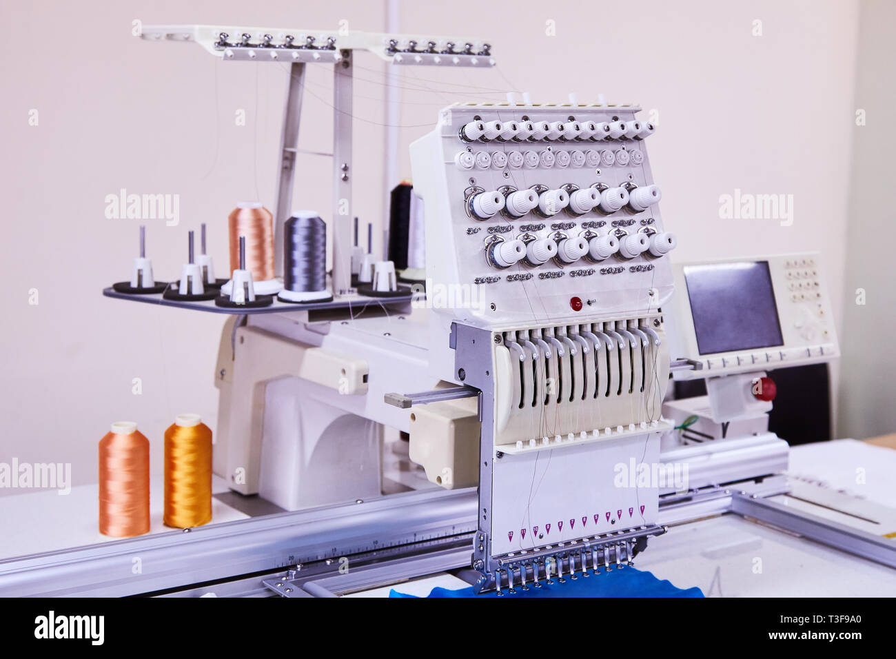 12 Needle Compact Embroidery Machine. Industrial Embroidery - Stock Image