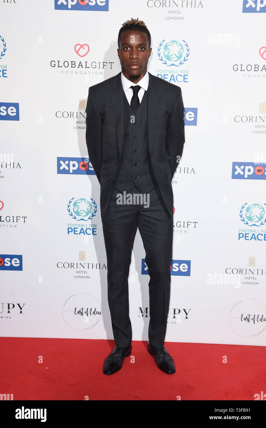 London, UK. 08th Apr, 2019. LONDON, UK. April 08, 2019: Wilfred Zaha arriving for the Football for Peace initiative dinner by Global Gift Foundation at the Corinthia Hotel, London. Picture: Steve Vas/Featureflash Credit: Paul Smith/Alamy Live News Stock Photo