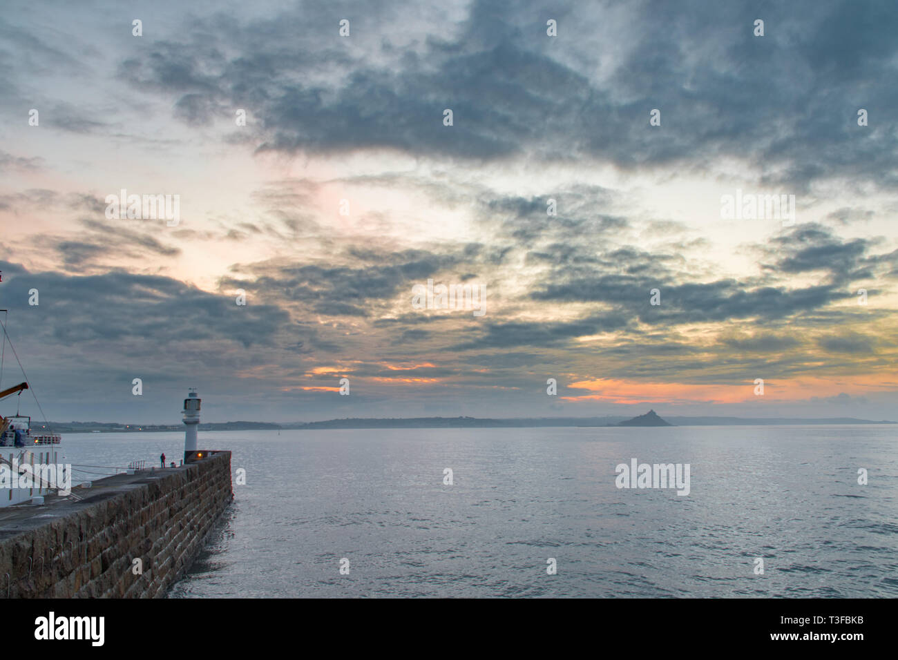 Penzance, Cornwall, UK. 9th Apr, 2019. UK Weather. It was mild and warm for the sunrise at Penzance this morning. Early morning clouds soon lifted. Credit: Simon Maycock/Alamy Live News Stock Photo