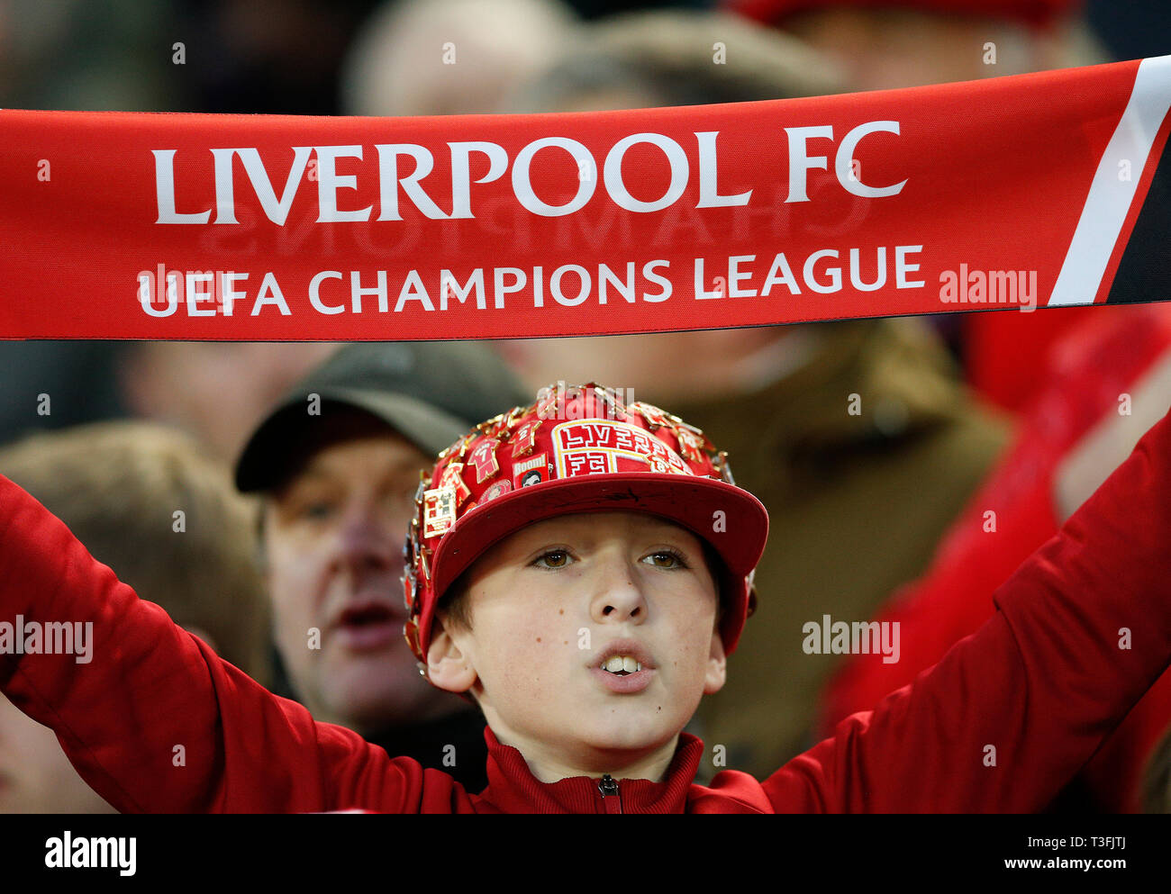Liverpool, UK  09th Apr, 2019  A young Liverpool fan holds