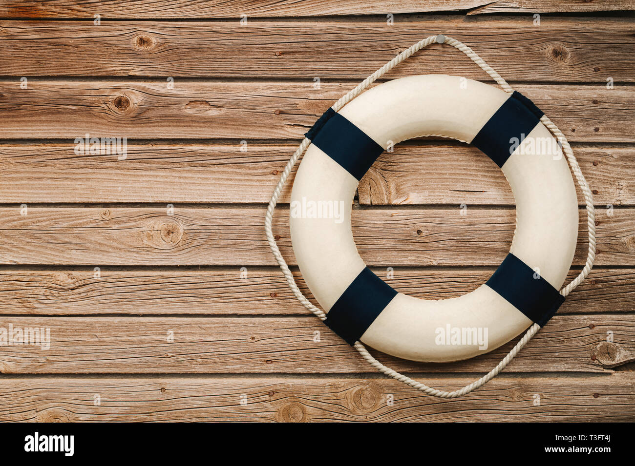 Close up of life buoy on the wooden background with copy space Stock Photo