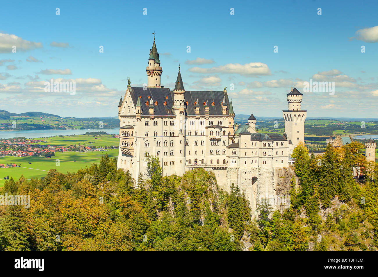 Beautiful view of world-famous Neuschwanstein Castle, the 19th century Romanesque Revival palace built for King Ludwig II, with scenic mountain landsc - Stock Image