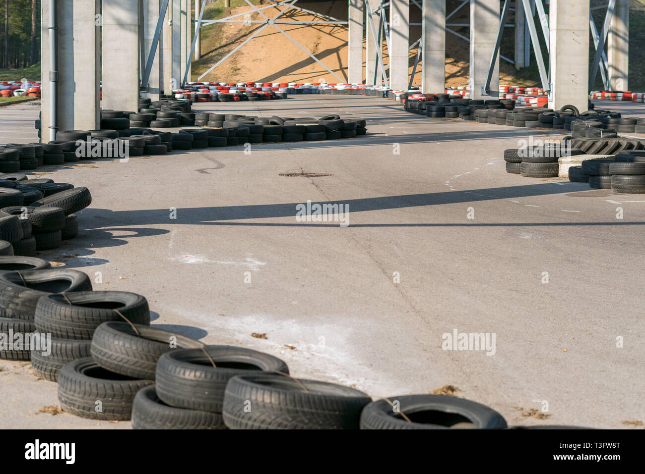 Go-kart racetrack circuit. Small karting racetrack, snake run formed out of car tires, motorsport for youth - Stock Image