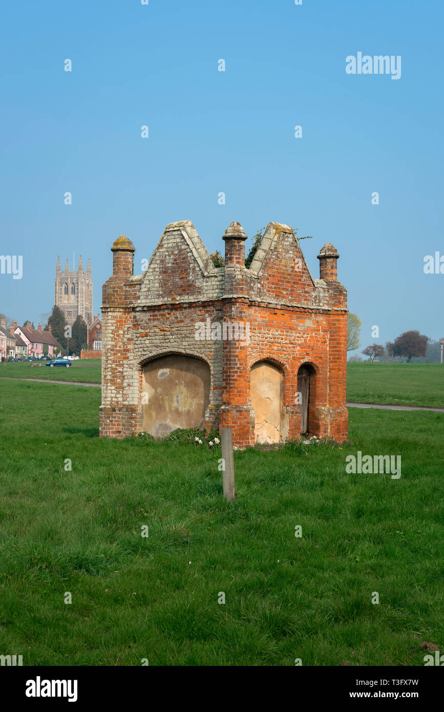 View of a Tudor brick water conduit sited in The Green in the Suffolk village of Long Melford, Suffolk, England, UK. - Stock Image