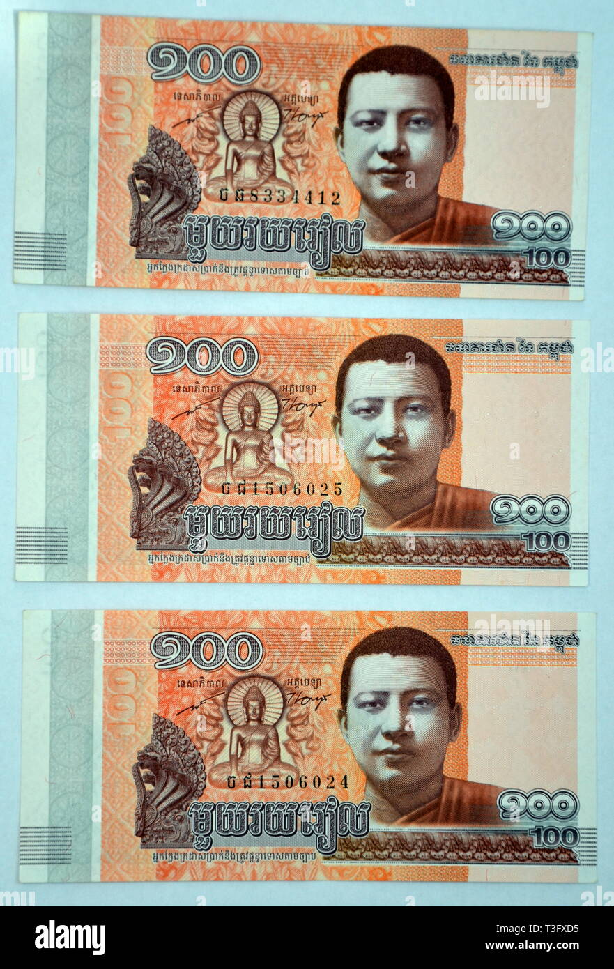 Cambodian 100 Riels Banknotes, Issued January 2015 by the National Bank of Cambodia, Showing King Father as a Young Monk - Stock Image