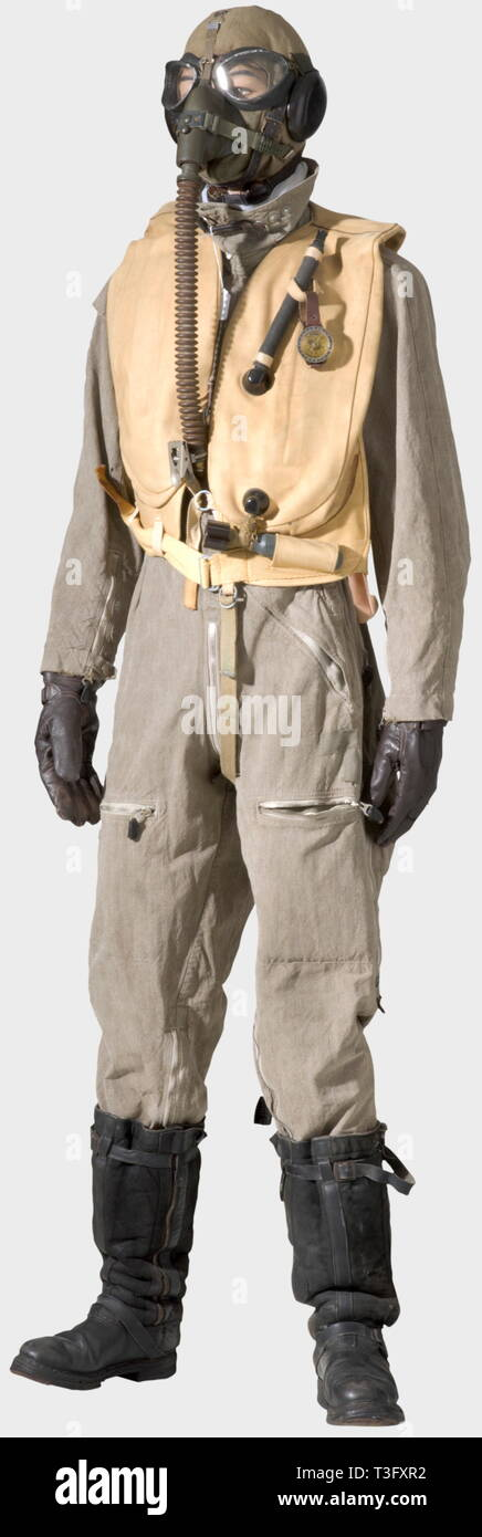 A pilot's uniform ensemble, during the aerial bombing of England, 1940 - 44 A pilot's helmet of sand-coloured linen with brown leather pieces in the very rare early version with the throat microphone on the side, type Siemens Lkp 100, Fl 31216, complete with cable and connector plug. Summer flying suit of sand-coloured linen ('Prym' buttons, 'Zipp' or Rheinnädel' zippers, repairs in places). Pilot's white silk scarf. Dark leather, fur-lined flying boots, early model with two zippers (repaired in places). Long, brown leather, pilot's historic, historical, people, 1930s, 20th, Editorial-Use-Only - Stock Image