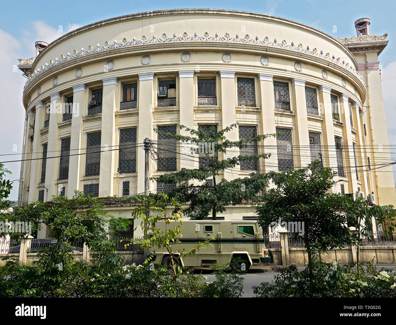 Manila, Philippines: Side view of the historical Central Post Office building near the Pasig River, with an armored car in front - Stock Image