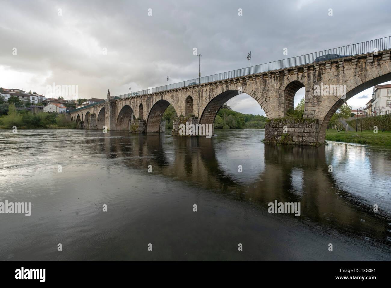 Medieval stone bridge over the Lima river in Ponte da Barca, Minho, Portugal, Europe - Stock Image