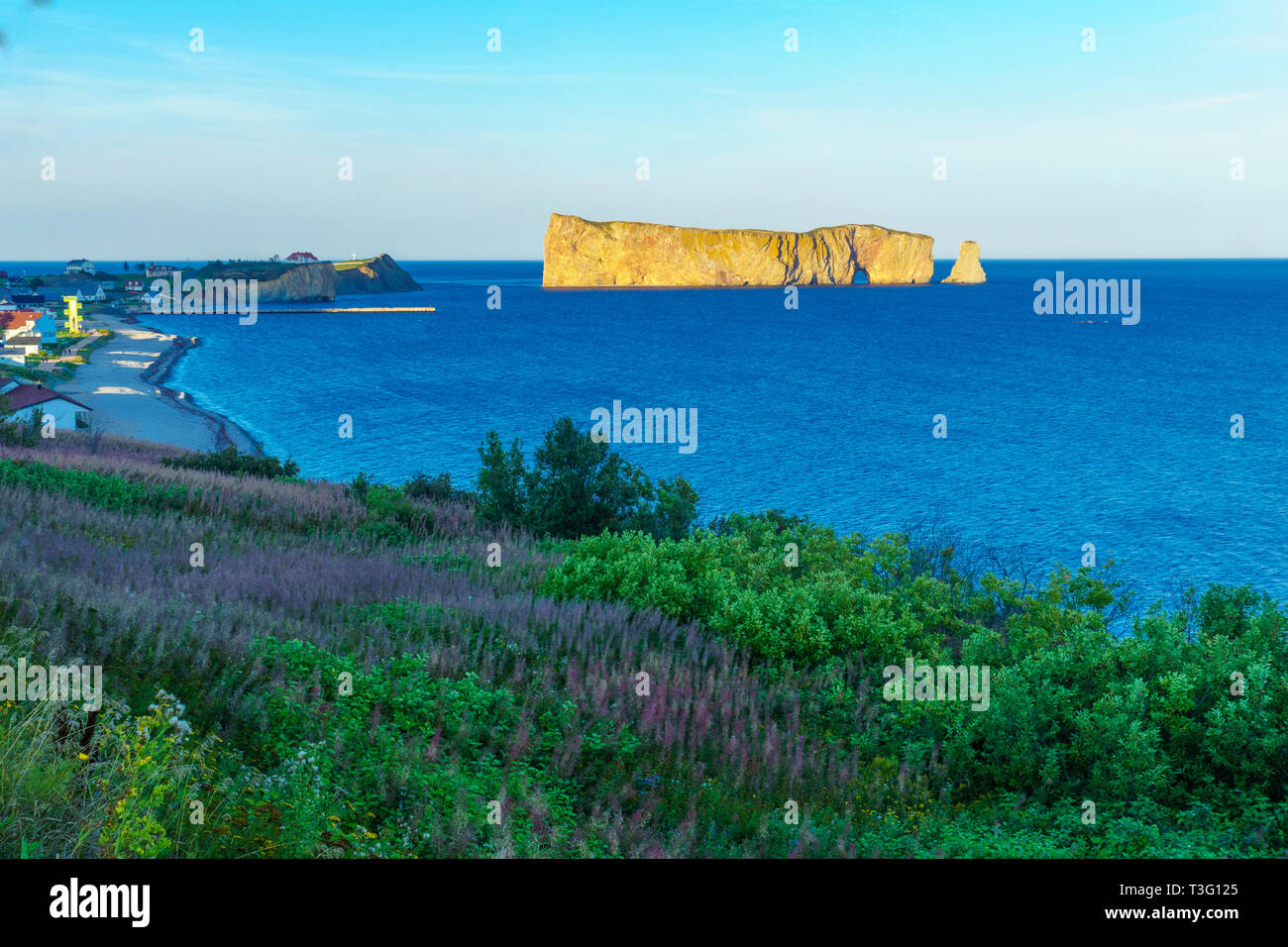 View of the Perce rock, and Perce village, at the tip of Gaspe Peninsula, Quebec, Canada - Stock Image