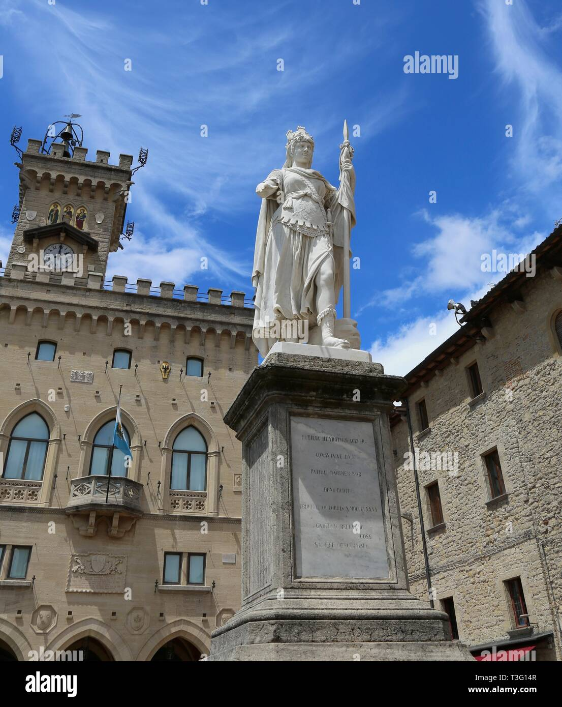 San Marino, SM, san Marino Republic - June 6, 2017:  Statue of Liberty in the main square of microstate of San Marino and the ancient palace called Pa - Stock Image
