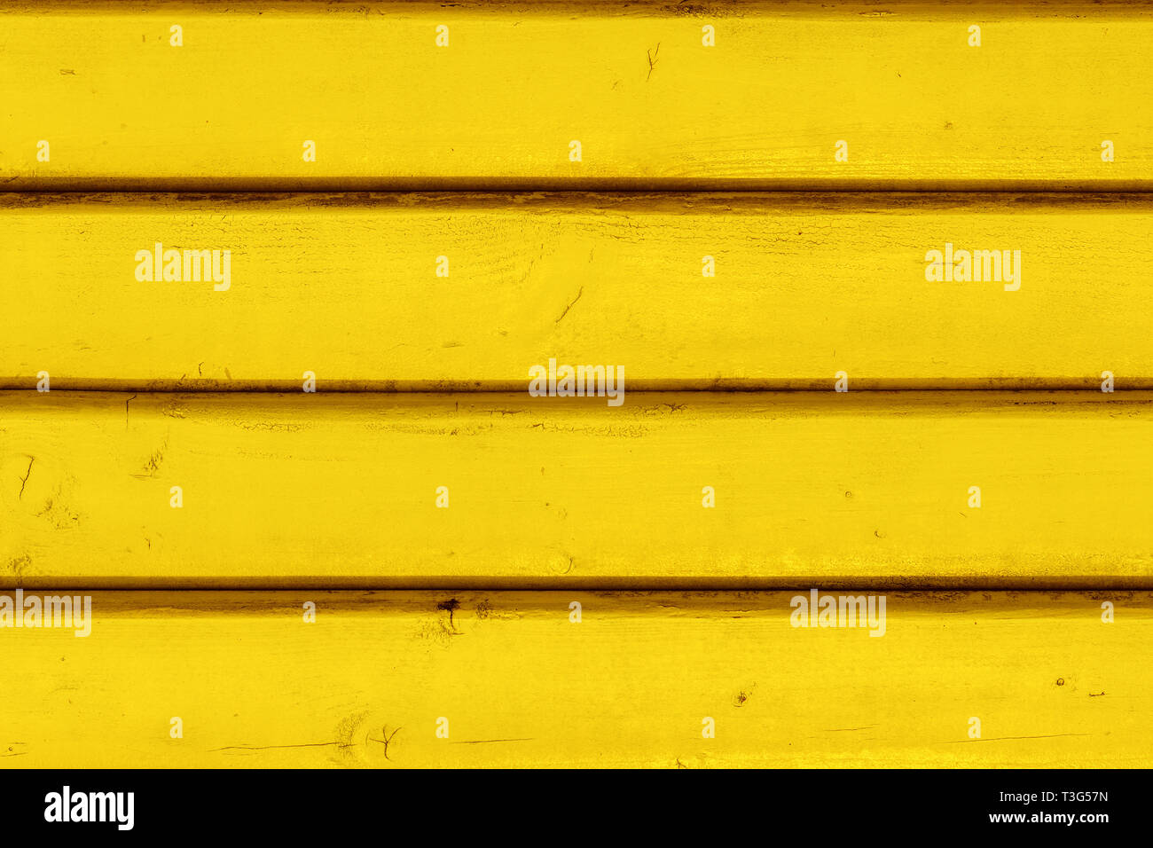 Yellow vintage wooden boards in overlap cladding pattern, front view as copy space or graphic design background - Stock Image