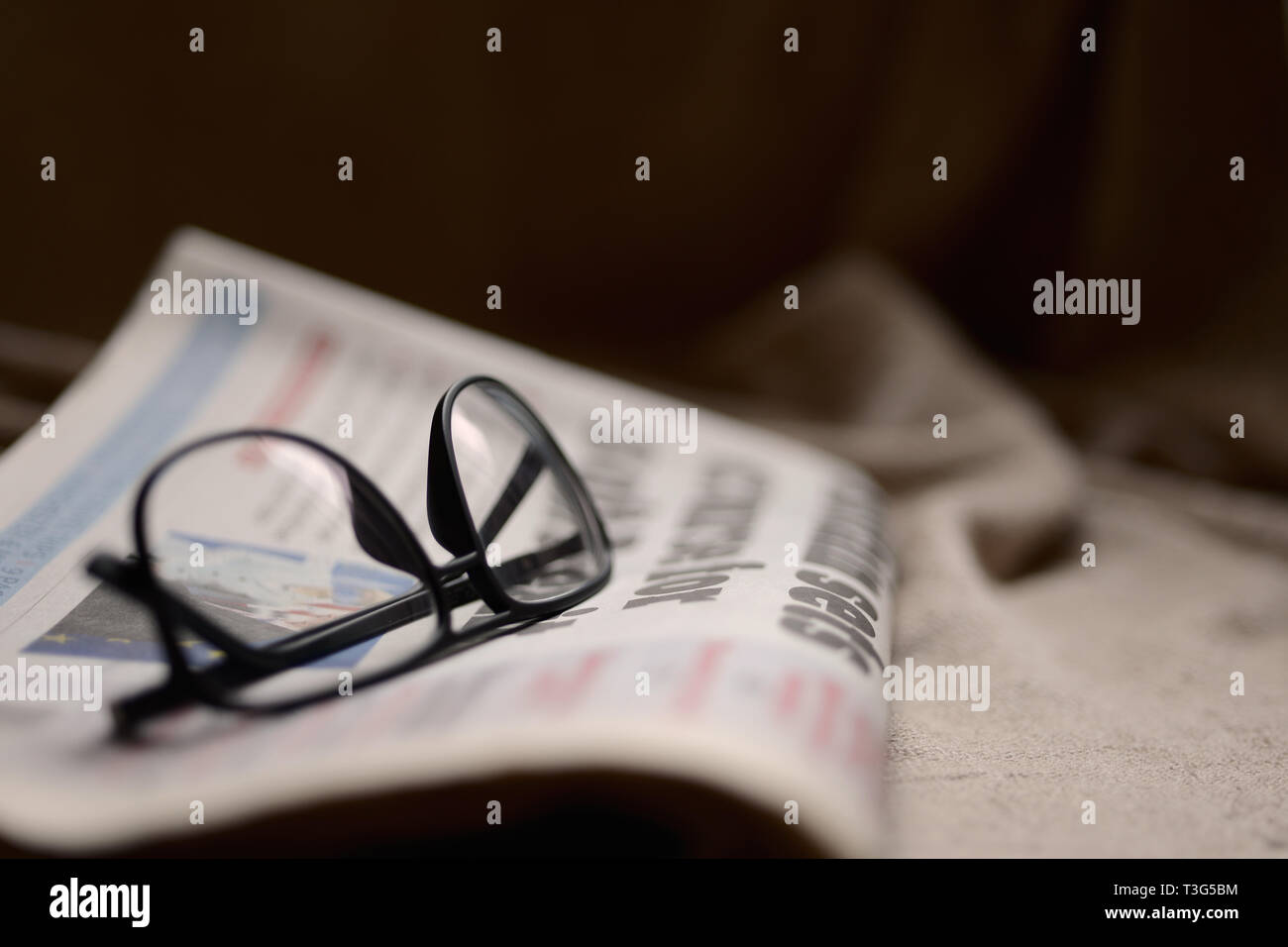 Glasses on top of a newspaper with copyspace Stock Photo
