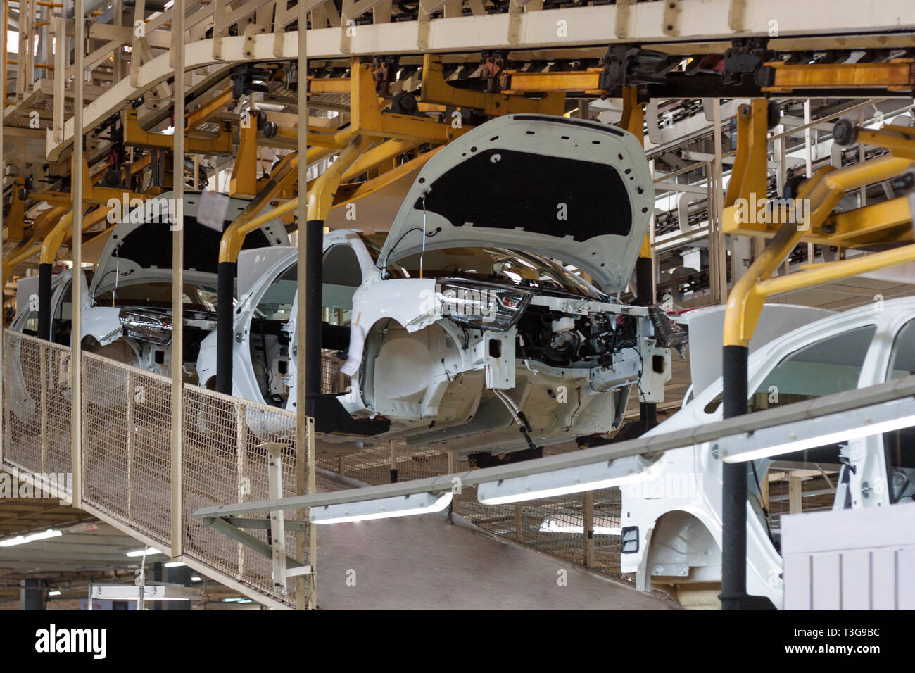 Russia, Izhevsk - December 15, 2018: LADA Automobile Plant Izhevsk. The bodies of new cars after painting on the conveyor line. - Stock Image
