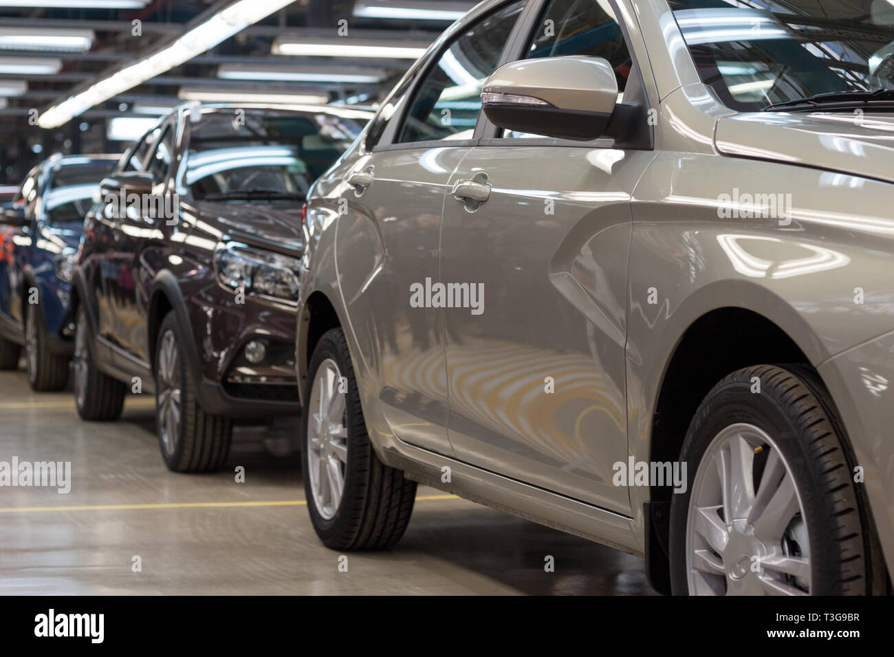 Russia, Izhevsk - December 15, 2018: LADA Automobile Plant Izhevsk, part of the AVTOVAZ Group. New modern cars Lada ready for sale. Modern transportat - Stock Image