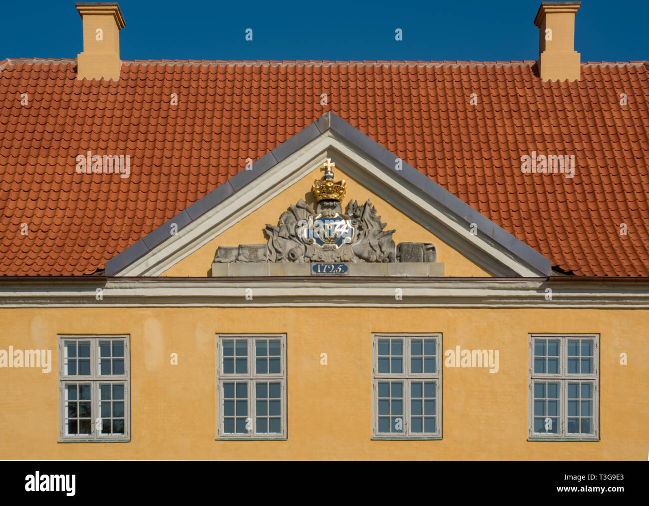 Detail of the pediment of the Commander's House in Kastellet, Copenhagen with Christian vII's monogram topped by a crown - Stock Image