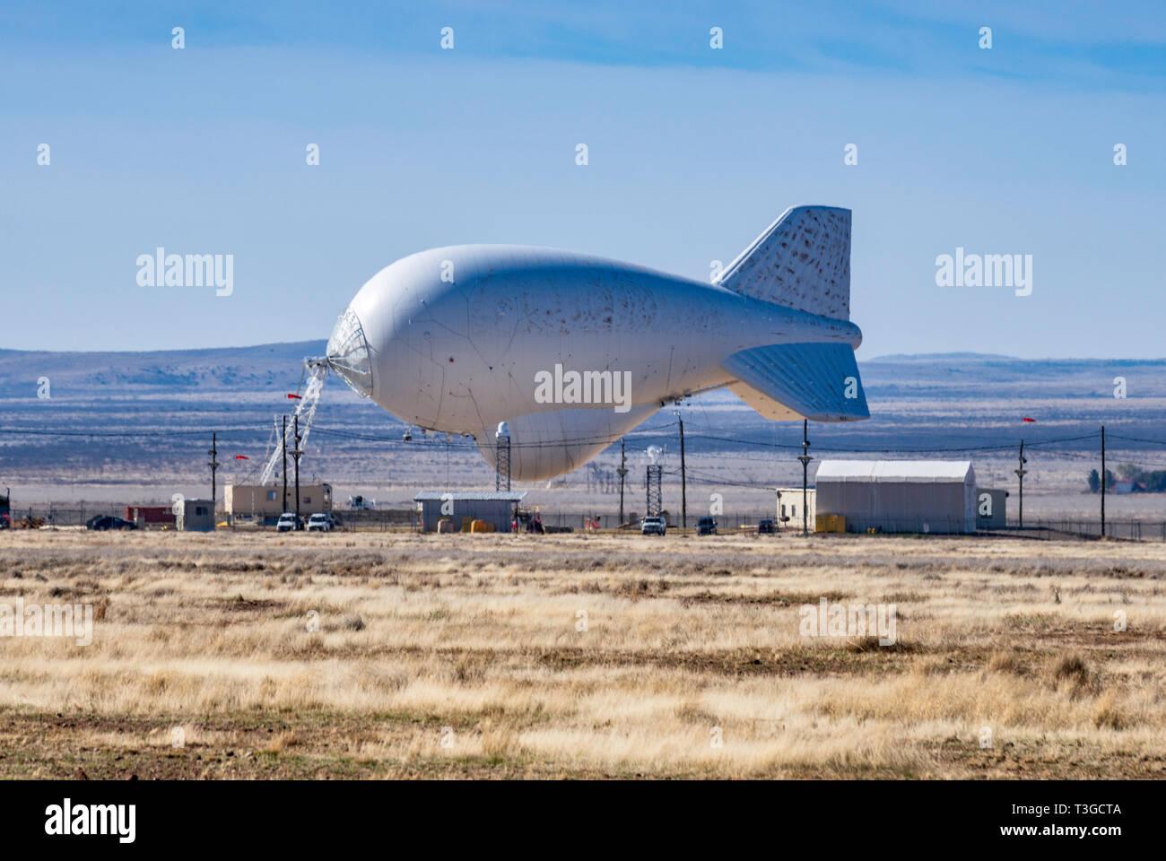 Lockheed Martin 420K aerostat, TARS, or Tethered Aerostat Radar System, helium-filled balloon with downward-looking radar for drug smugglers aircraft  - Stock Image