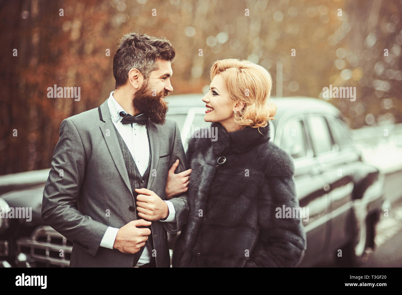 71412860d9 Happily married couple enjoying a beautiful day outdoorsat antique car, handsome  wealthy man and his gorgeous female posing outdoors, people spending