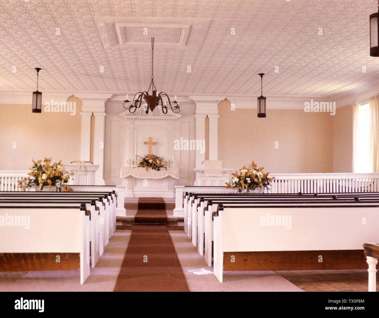 Interior of empty pews inside church in 1960s (ca. 1966-1967) - Stock Image
