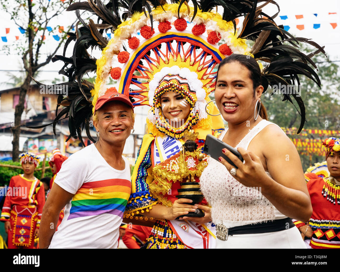 Cebu City , The Philippines - January 20, 2019: Viewers are photographed with a potential Queen of Sinulog. The Sinulog is an annual colorful religiou - Stock Image