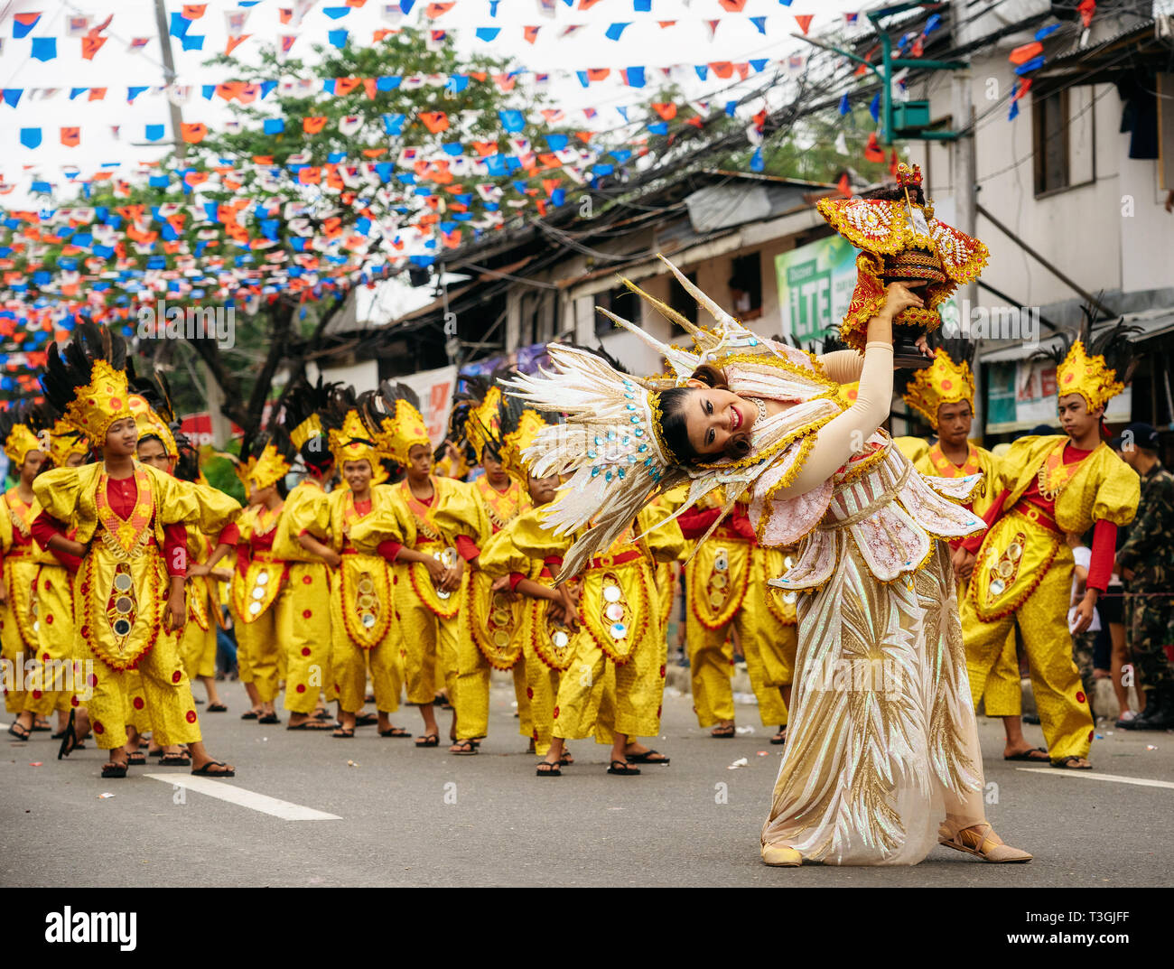Cebu City , The Philippines - January 20, 2019: Street dancers in vivid colorful costumes participate in the parade at the Sinulog Festival. - Stock Image