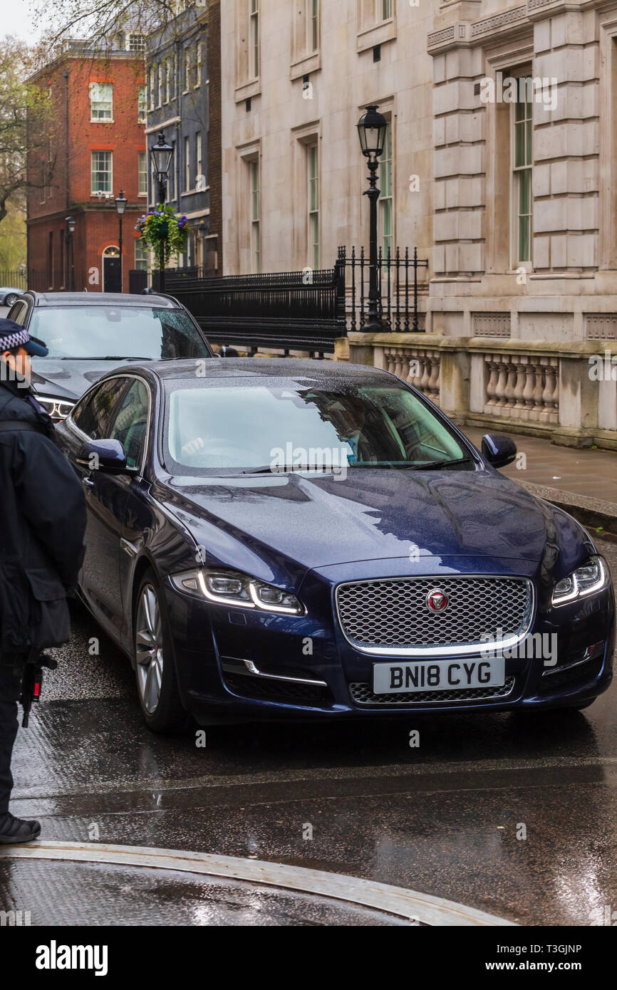 Ministerial Car Leaving Downing Street Through Gates and Armed Police - Stock Image