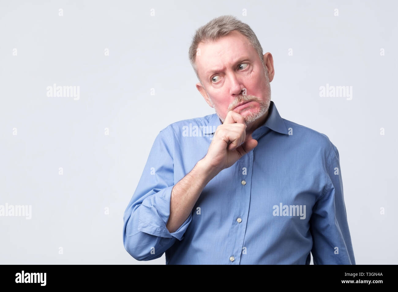 an thinking about his problems, expressing some doubts - Stock Image