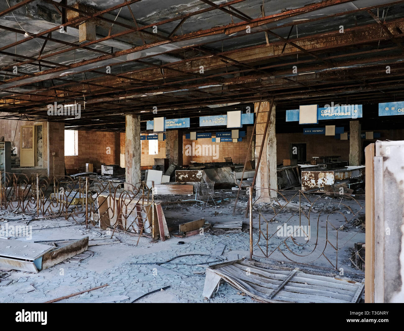 Abandoned supermarket in the ghost town of Pripyat inside the exclusion zone of Chernobyl, Ukraine, April 2019 Stock Photo