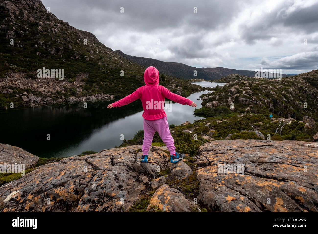 Little hicker girl in pink at Tarn Shelf Track. Mt Field. Tasmania - Stock Image