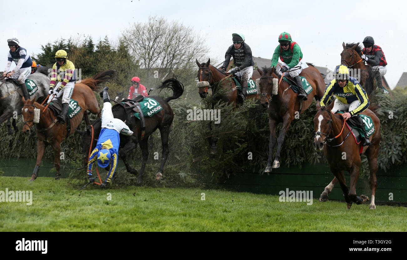 Charlotte Crane falls from Seefood at Becher's Brook during Grand National Thursday of the 2019 Randox Health Grand National Festival at Aintree Racecourse. - Stock Image