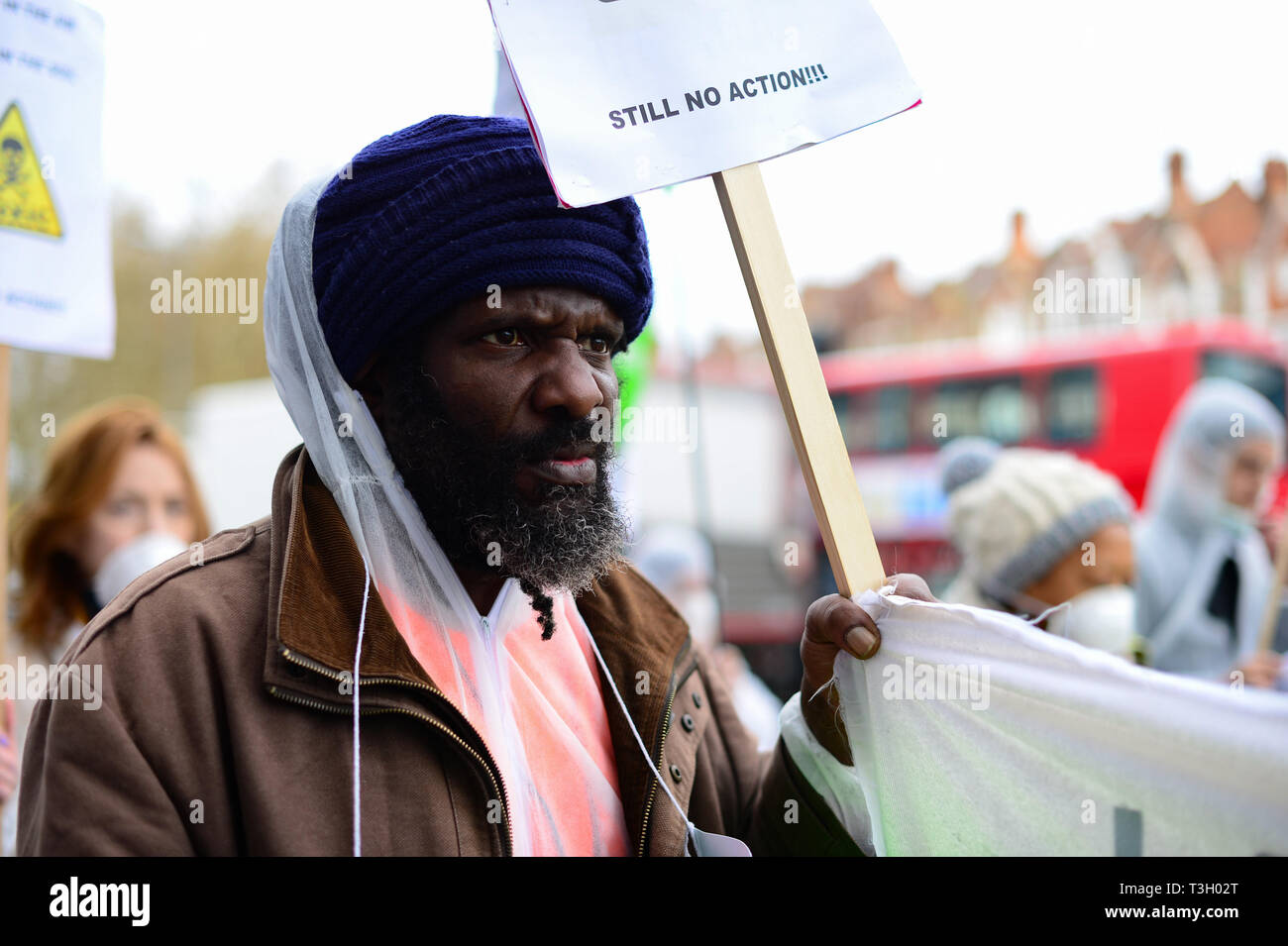 Members of the public take part in a protest accusing authorities of lying after cancer-causing chemicals were found in soil close to Grenfell Tower. Stock Photo