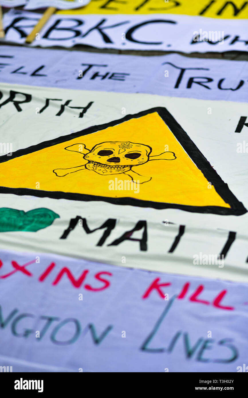 Banners used in west London in a protest accusing authorities of lying after cancer-causing chemicals were found in soil close to Grenfell Tower. - Stock Image