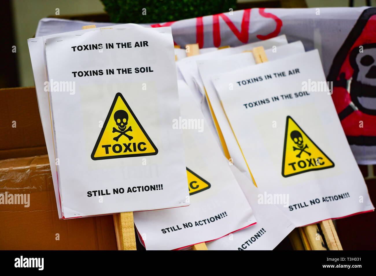 Banners used in west London in a protest accusing authorities of lying after cancer-causing chemicals were found in soil close to Grenfell Tower. Stock Photo