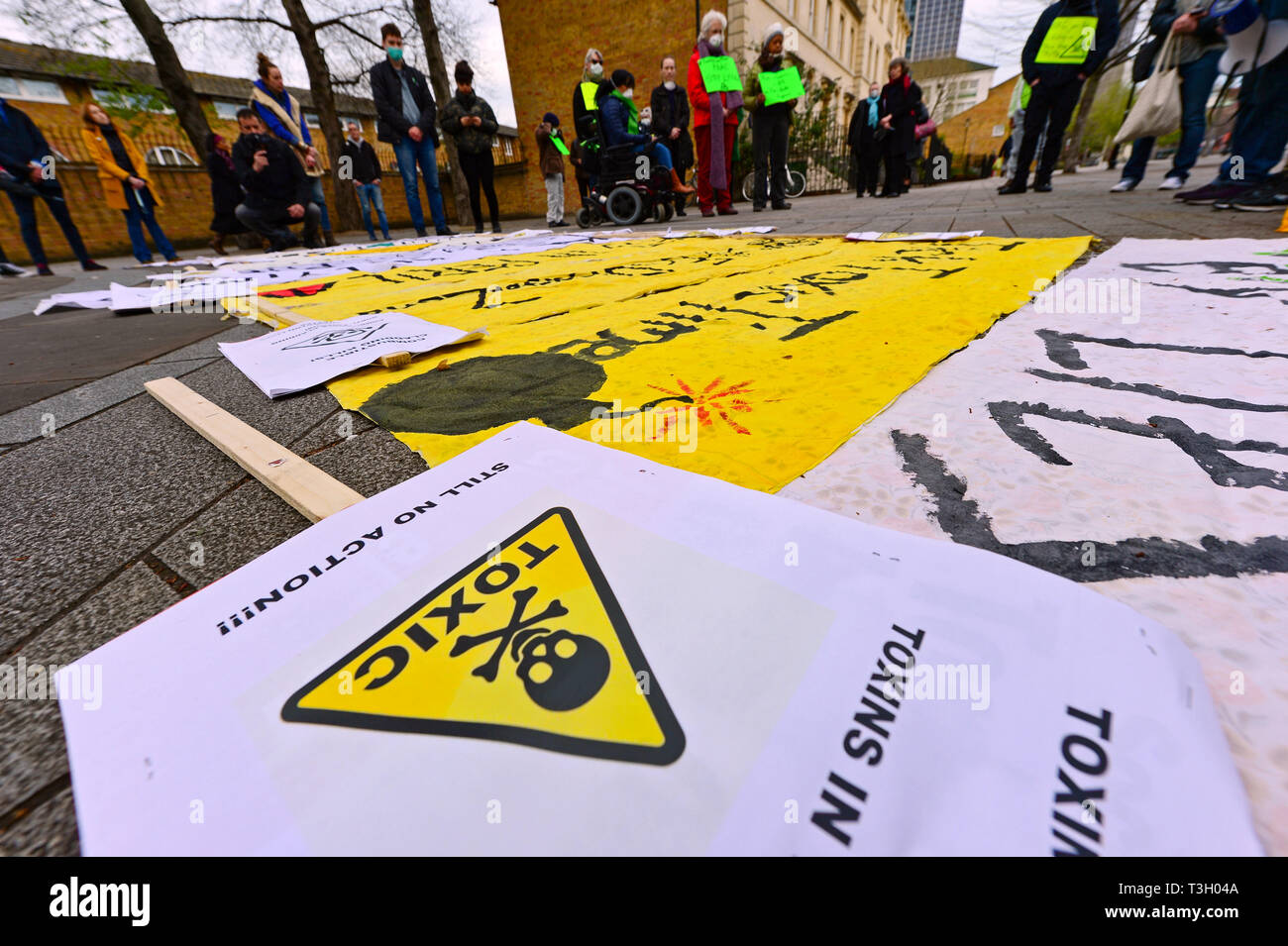 Crowds gather in west London to support a protest accusing authorities of lying after cancer-causing chemicals were found in soil close to Grenfell Tower. - Stock Image