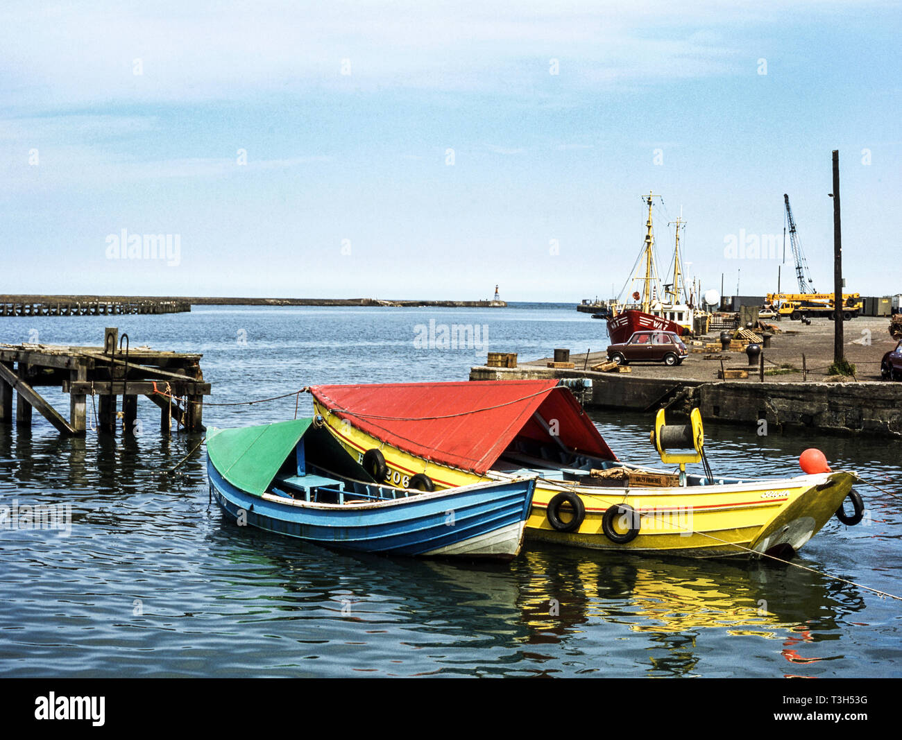 Northumberland 'Coble' fishing boat in Amble village harbour .Northeast England. - Stock Image