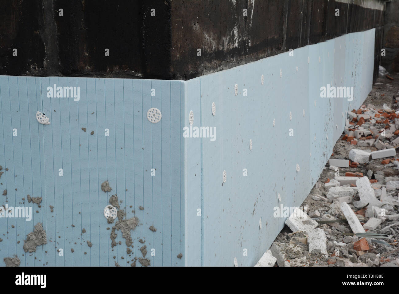 Basement rigid insulation details with damp proofing photo. House foundation insulation for energy saving. - Stock Image