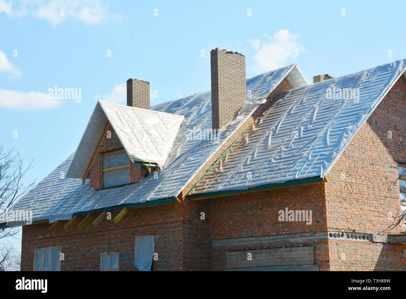 Roofing material Waterproof for thermal-insulation and waterproofing, warm roof construction and roof waterproofing membrane. - Stock Image