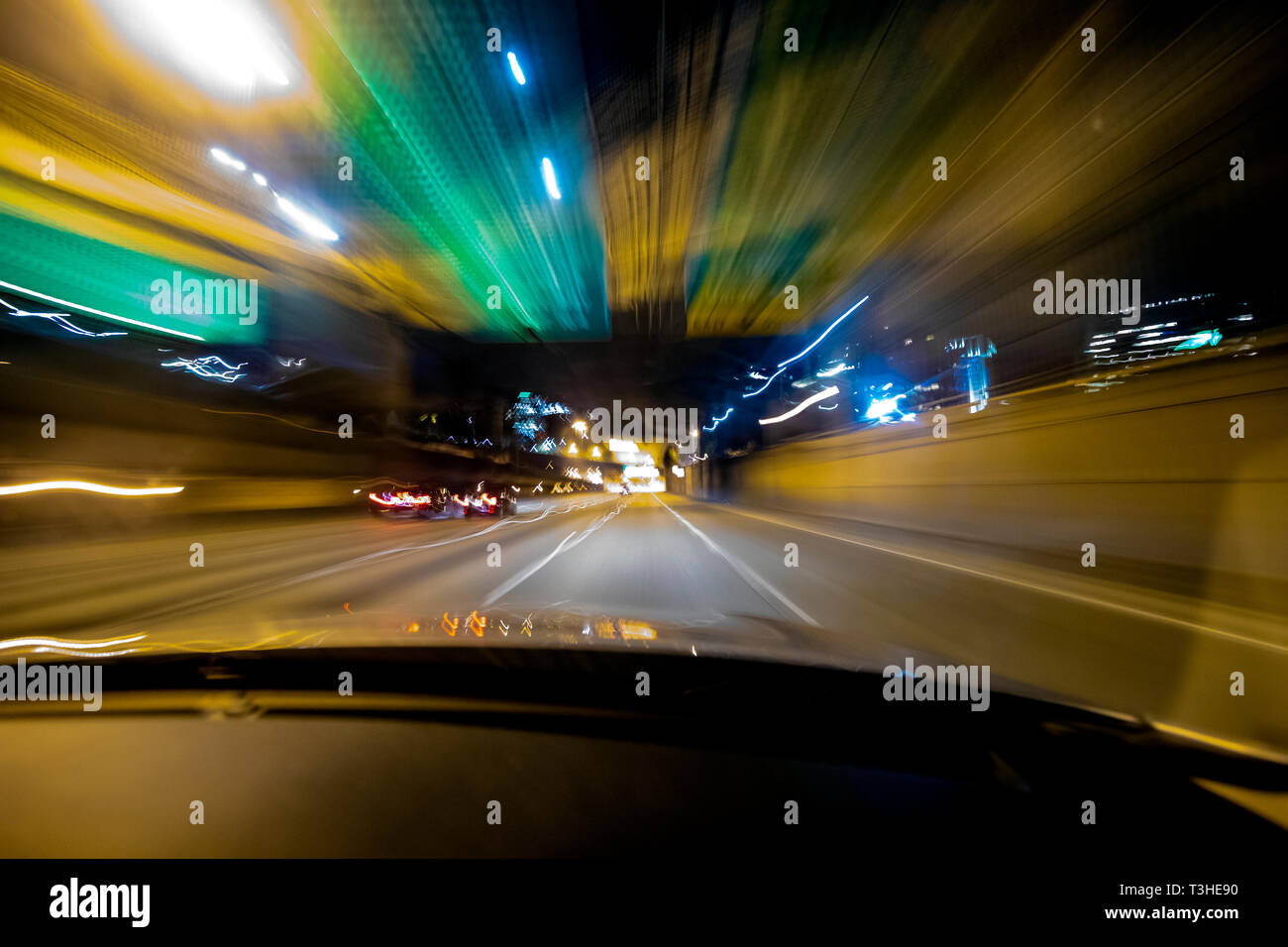 WA17078-00...WASHINGTON -  Driving Interstate 5 at night near Seattle. - Stock Image