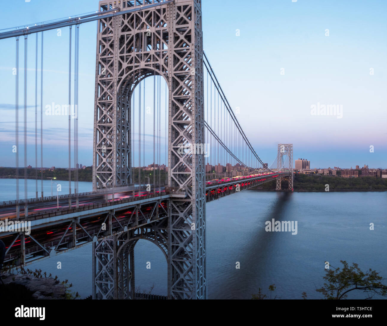 A panoramic view of George Washington Bridge as taken from Fort Lee, New Jersey connecting to NYC across Hudson river - Stock Image